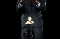 Businessman holding puppet