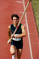 Male Pole Vaulter Sprinting Down the Track
