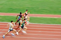Male Runners Sprinting Down Track