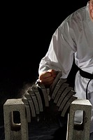 Blackbelt Breaking a Stack of Concrete Blocks
