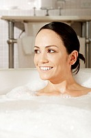 Close-up of a young woman in a bubble bath