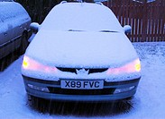 UK, Wales, Powys, car covered in snow