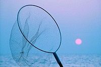 Thailand, Pattaya, Jomtien Beach, Fisher net against sunset [blue]