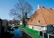 The Netherlands, Friesland, Hindeloopen, houses near canal