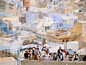 Crowds of Muslim men on roof top. Jodhpur, Rajasthan, India