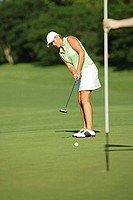 Female Golfer Making a Putt
