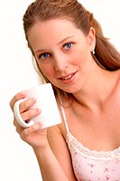 A woman posing with a white cup