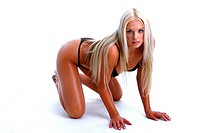 A blonde hair woman in black bikini crouching on the floor