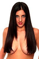 A topless woman covering her breasts with her long hair