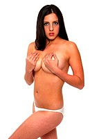 A topless woman covering her breasts with her hands