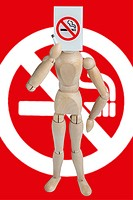 Dummy holding a no smoking sign