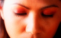 Woman closing eyes (thumbnail)