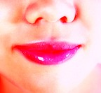 Woman's lips with lipstick applied