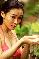 Woman in bikini taking shower