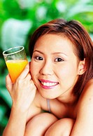 Woman holding a glass of orange juice
