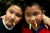 Boys playing with french fries