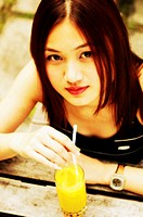 Woman drinking a glass of orange juice (thumbnail)