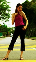 Woman posing in the middle of the road