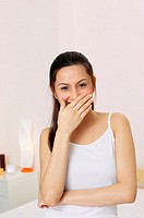 Woman covering her mouth while laughing (thumbnail)