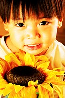 Young boy holding a sunflower