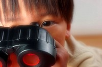 Boy playing with a binoculars