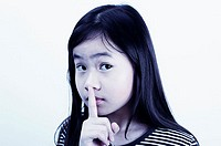 Girl showing a hushing sign