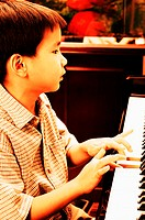 Boy practising piano
