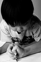 Boy watching his parent drawing