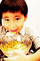 Boy having his cereal breakfast