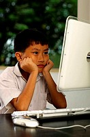 Boy using computer (thumbnail)