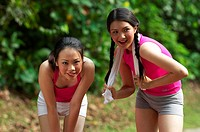 Women feeling tired after jogging