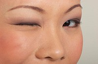 Woman winking her eye (thumbnail)