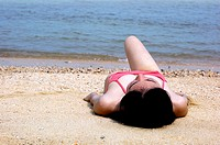 Woman lying on the beach
