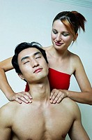 Woman giving her boyfriend a shoulder massage