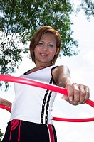 Woman playing hulla hoop