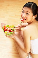 Woman eating fruits.