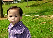 Boy looking at the camera (thumbnail)
