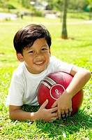 Boy posing with a ball