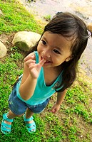 Girl biting her finger