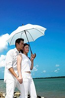 Couple sharing an umbrella