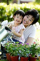 Mother and daughter watering plants (thumbnail)