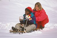 Kids playing with Snow Sleigh, Boy 10 yrs, Girl 11 yrs, MR, Atlanta, GA