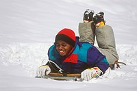 Boy playing on Snow Sleigh, 10 yrs old, MR, Atlanta, GA