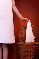 woman holding towel in the laundry
