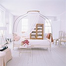 Bedroom with canopy over bed