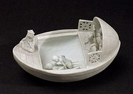 Model stoneware boat with several figures on board. The central canopy can be removed to show a man and woman making love.