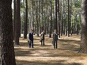 Office workers in forest (thumbnail)