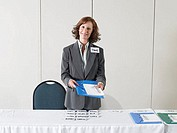 Businesswoman with name tags