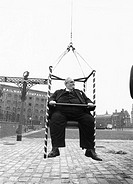 'Cyril Smith hanging by a thread at G-Mex. The 28-stone Liberal MP was hoisted up in a special chair to prove the strength of a new pencil-thin rope a...
