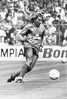 Singer Rod Stewart playing football.